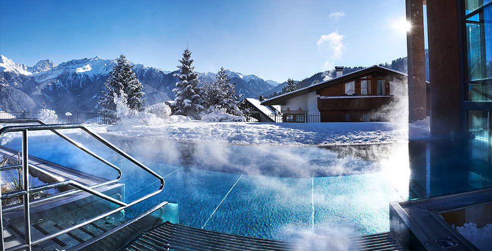 ski-in ski-out at 5-star hotel Schlosshotel Fiss Tyrol Austria Aqua Monte exterior view (c) Mario Rabensteiner