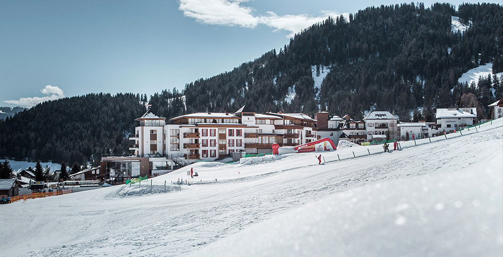 ski-in ski-out at 5-star hotel Schlosshotel Fiss Tyrol Austria exterior view winter