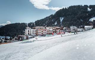 ski-in ski-out at 5-star hotel Schlosshotel Fiss Tyrol Austria exterior view winter teaser
